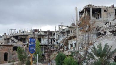 Zniszczona dzielnica w Homs